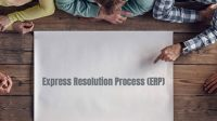 "Overhead shot of people's arms and paper with the words ""Express Resolution Process (ERP)"" on it"
