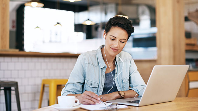 Writers graphic - woman on laptop making notes